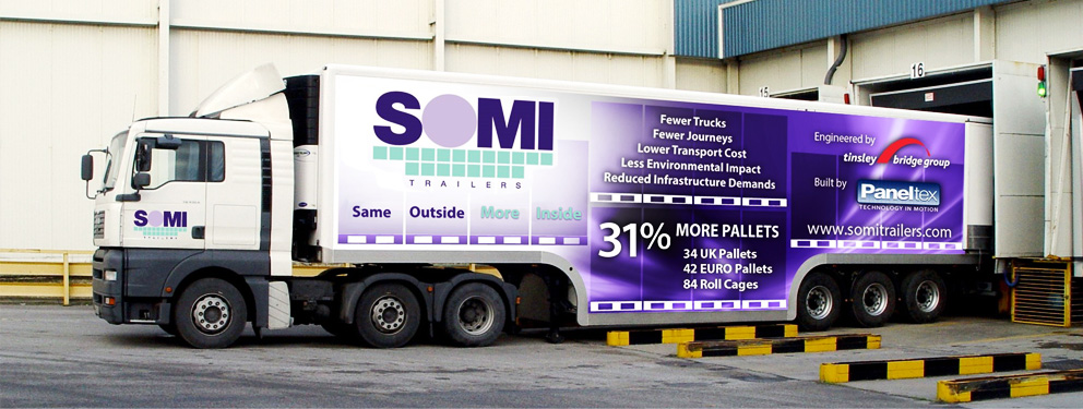 A SOMI Trailer emerging from a loading bay